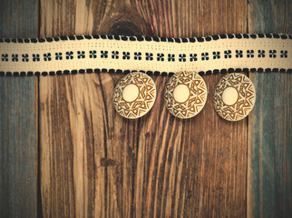 Vintage tape with embroidered pattern and three ancient buttons