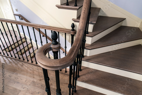 Tela Staircase with cast iron balusters and wooden steps