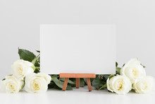 White Card Mockup With Roses On A White Table.
