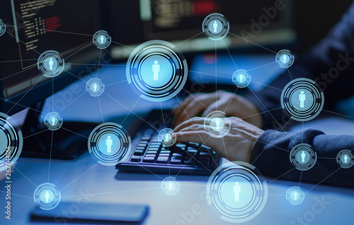 cybercrime, hacking and technology concept - hands of hacker