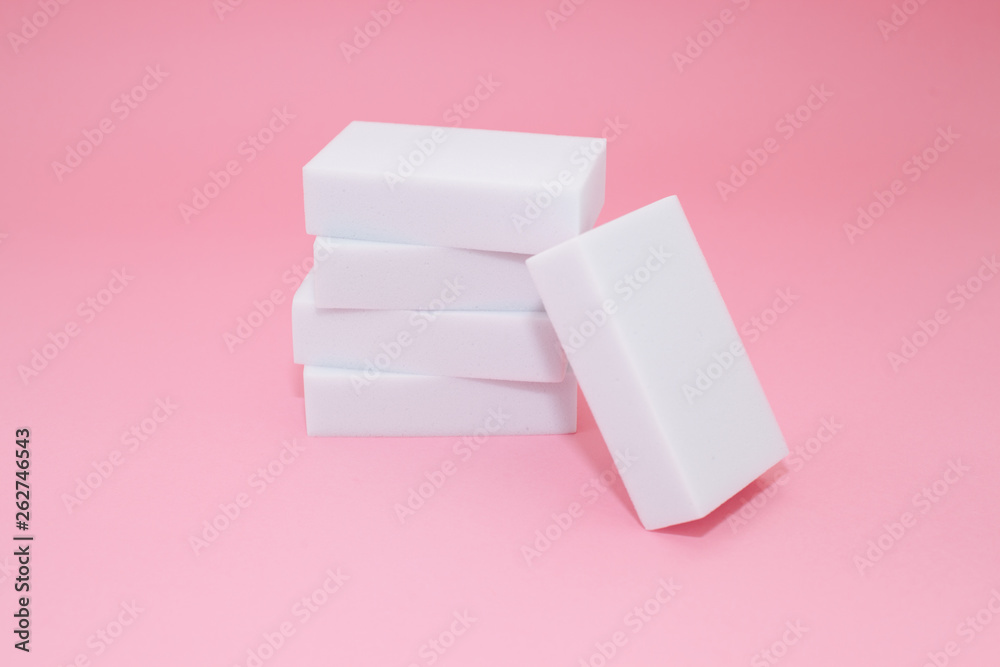 Fototapeta Melamine household sponge stack with four sponges for cleaning on pink background. Cleaning concept