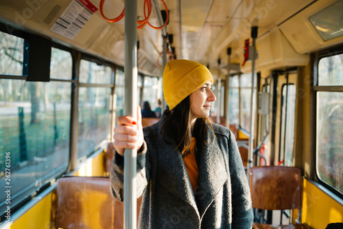 Young woman standing in a wagon of a driving tramway Canvas Print