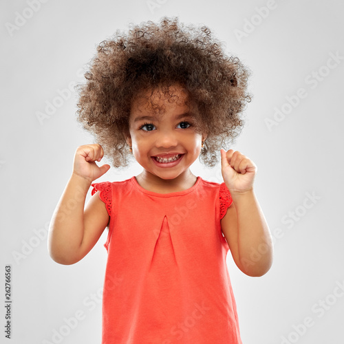 Fototapeta childhood and people concept - happy little african american girl over grey background obraz na płótnie