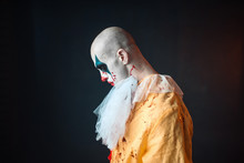 Sad Bloody Clown With Makeup In Carnival Costume