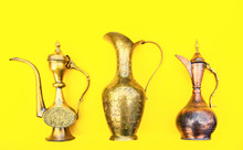Very Old Copper Ewer, Water Jar On Isolated Yellow Background
