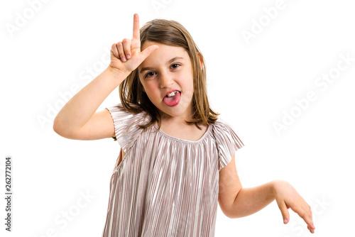 Fotografiet Portrait of happy girl making loser hand gesture at camera.