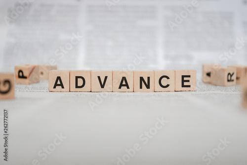 Photo Advance Word Written In Wooden Cube - Newspaper
