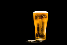 Beer Glass With White Foam On Dark Background