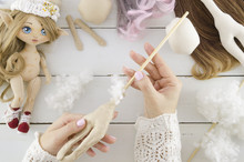 Handmade Rag Doll Production. Top View Crafting With Hands On Wooden Table Workspace