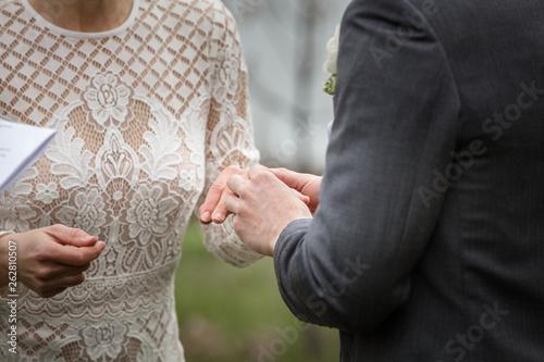 Obraz na plátně Putting ring in bride's hand
