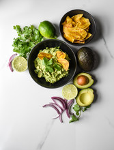 Bowl Of Guacamole And Chips Wi...