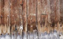 Green Padlock On Old Brown Wooden Door