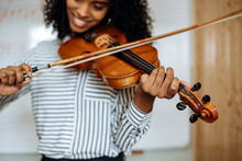 Young Woman Playing Violin Wit...