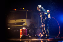 Muscular Firefighter On Mission
