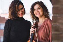 Two Women Musician Smiling Outdoors