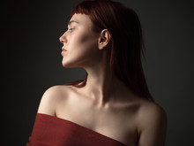 Portrait Of A Young Woman With Bare Shoulders
