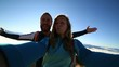 Cheerful young couple on mountain top take selfie