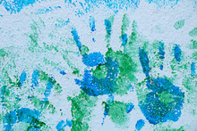 Multicolored Handprints Of Children's Hands On The Wall
