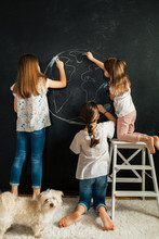 Young Girl Drawing Planet Eart...