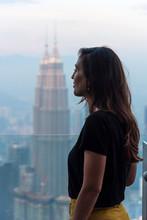 Woman Looking The Skyline Of Kuala Lumpur, Malaysia