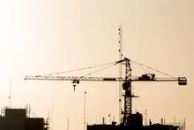 Silhouette Of Crane On Site