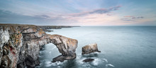 An Natural Arch Out Into A Calm Blue Sea