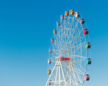 Colorful Ferris Wheel On Blue Sky