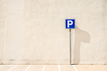 Parking Sign Against Simple Wall