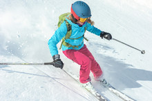 Woman Skiing Down The Slope
