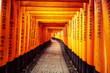 Leinwanddruck Bild - Red Torii gates in Fushimi Inari in Kyoto, Japan.