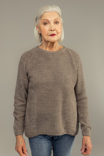 Pleasant Grey Haired Woman Wearing A Pullover