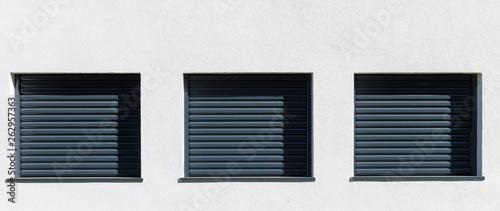 Canvas-taulu volets roulants aluminium sur façade