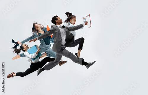 Fotografie, Obraz  Happy business women and african man dancing isolated on white.