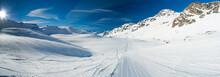 Skiers On A Piste In Alpine Sk...