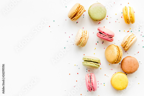 Fotobehang Macarons Macarons design on white background top view space for text