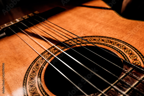 close up of an acoustic guitar - 262996906