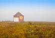 Lone barn on a foggy morning