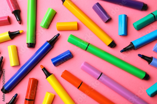 Photo  Flat lay composition with markers on color background