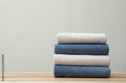 Fotomural Stack of fresh towels on table. Space for text