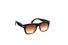 Isolated Image Of Brown Gradient Sunglasses Shown From Front Left View. Leopard Patterned Texture At Bottom Of The Frame. Earpiece Part Is Black Colored And Thick. Style Of The Glasses Is Retro Style.