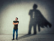 man casting a superhero with cape shadow on the wall