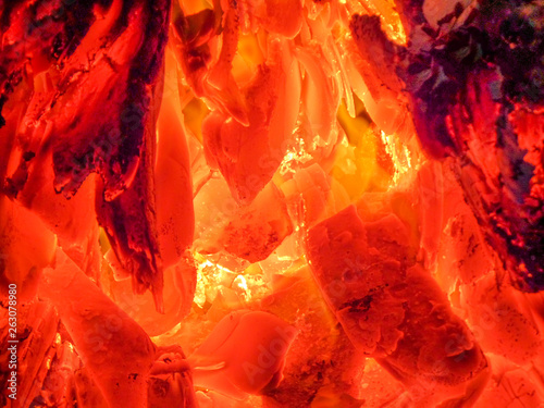 Fire on a black background. Burning coals and flames. Fototapet