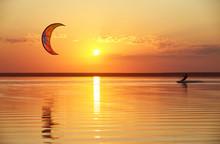 Kitesurfing On The Lake At Sunset