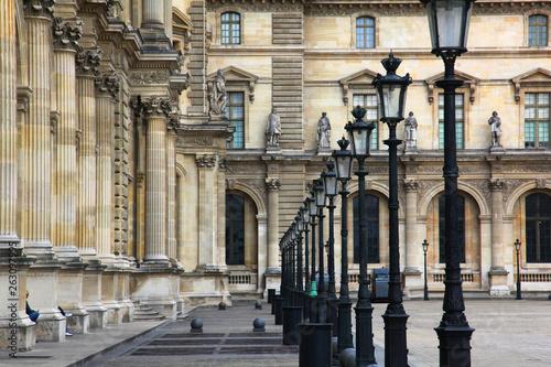 Fotografie, Obraz  Street lamps at the Louvre in Paris