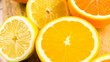 Variety of citrus fruit including lemons lines grapefruits and oranges.