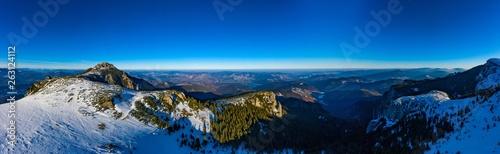 Colline Dochia chalet and Toaca peak at sunrise in Ceahlău Mountains National in winter season,Aerial winter Landscape