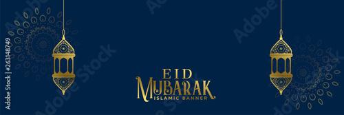 Fototapeta elegant eid festival banner with hanging lamps obraz