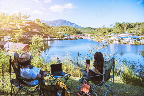 Spoed Foto op Canvas Kamperen Camping Relaxing couples are happy to sit for breakfast. Morning time at camping site in Ban Rak Thai village, Travel nature.
