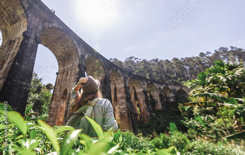 Cuadros en Lienzo Woman looks at the Demodara nine arches bridge the most visited sight of Ella to