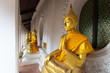 Gold buddha statue at temple in Thailand.
